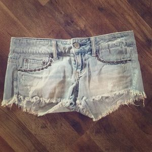 American Eagle studded jean shorts